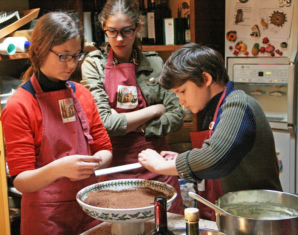 Kids shaving Balinese chocolate on Tiramisu in Italy