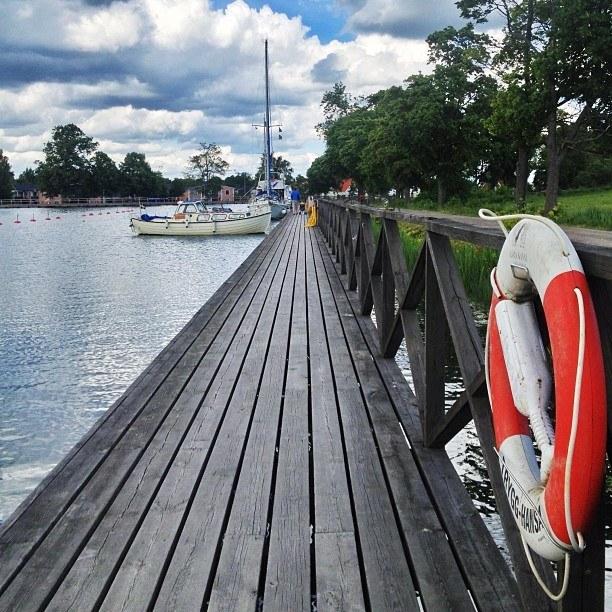 boats in a dock Vadstena   Instagram travel photo by skimbaco http://instagram.com/skimbaco